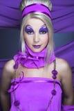 Flicka i violet Fotografering för Bildbyråer