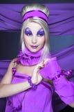 Flicka i violet Royaltyfria Bilder