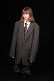 Flicka i vuxen affärsdräkt Royaltyfri Foto