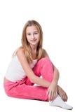 flicka isolerad sittande teen white Arkivbild