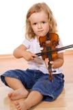 flicka little övande fiol Arkivbild