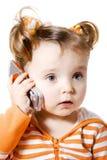 flicka little mobil telefon arkivbild