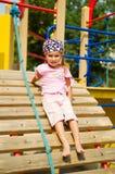 flicka little nätt lekplats Fotografering för Bildbyråer