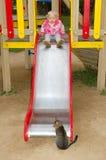 flicka little nätt parkspelrumlekplats Royaltyfri Fotografi