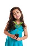flicka little ny växt Arkivbild