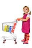 flicka little shopping Fotografering för Bildbyråer