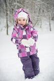 flicka little snow Royaltyfria Foton