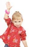 flicka little som är röd fotografering för bildbyråer