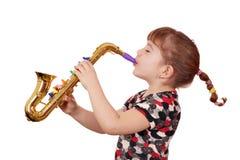 flicka little spelrumsaxofon Arkivbilder