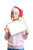flicka lyckliga röda santa Royaltyfria Bilder