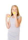 Flicka med äpplen Arkivfoto