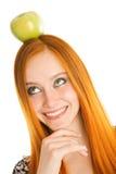 Flicka med äpplet Arkivfoto