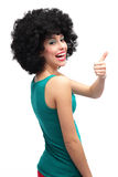 Flicka med afro visningtum upp Royaltyfri Fotografi