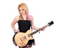 Flicka med att posera för gitarr Royaltyfria Foton
