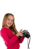 Flicka med att skratta för tappningkamera som isoleras på vit Arkivfoton