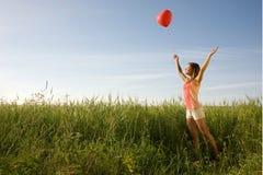 Flicka med ballongen Royaltyfri Foto