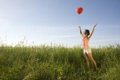 Flicka med ballongen Royaltyfria Foton
