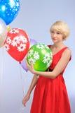 Flicka med ballonger Fotografering för Bildbyråer