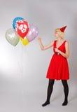 Flicka med ballonger Arkivbild