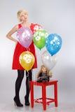 Flicka med ballonger Royaltyfria Foton