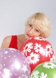 Flicka med ballonger Arkivfoto