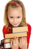 Flicka med böcker Arkivfoton