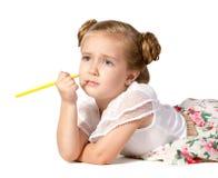 Flicka med blyertspennan i henne hand Royaltyfria Bilder