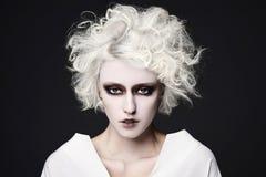 Flicka med clownsminket för halloween Arkivfoto