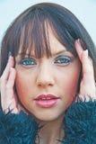 Flicka med dålig huvudvärk Arkivbild
