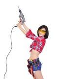 Flicka med den elektriska drillborren Arkivbild