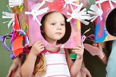 Flicka med dräkten för karneval fotografering för bildbyråer