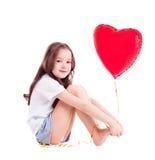Flicka med en ballong Arkivfoton