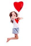 Flicka med en ballong Arkivbilder