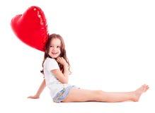 Flicka med en ballong Arkivbild