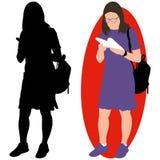 Flicka med en bok och en ryggsäck Royaltyfri Foto