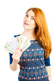 Flicka med en fan som göras av pengar Arkivfoton