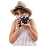 Flicka med en filmkamera royaltyfria bilder