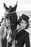 Flicka med en häst Arkivfoto