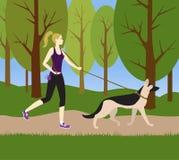 Flicka med en hund för en jogga Royaltyfri Foto