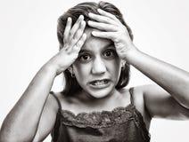 Flicka med en ilsken och desperat look mig Fotografering för Bildbyråer
