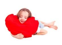 Flicka med en kudde Arkivbild