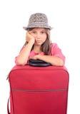 Flicka med en resväska arkivfoton