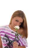 Flicka med en ros Arkivfoto