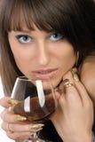 Flicka med ett exponeringsglas Arkivbild