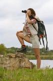 Flicka med fält-exponeringsglaset Arkivbild