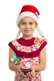Flicka med feriemuffin royaltyfri bild