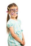 Flicka med fjärilsframsidamålning arkivbilder