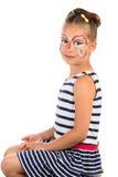 Flicka med framsidamålning royaltyfri bild