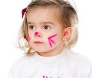 Flicka med framsidan i målarfärg Royaltyfria Bilder