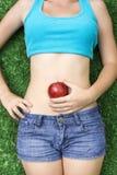 Flicka med frukt Royaltyfri Bild